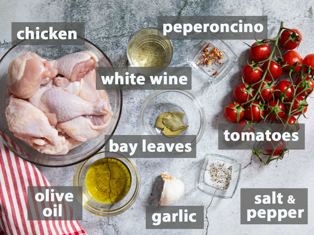 An image showing the ingredients needed to prepare a traditional chicken cacciatore.