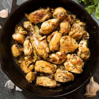 An overhead shot of a skillet of Spanish Garlic Chicken, straight out of the oven.