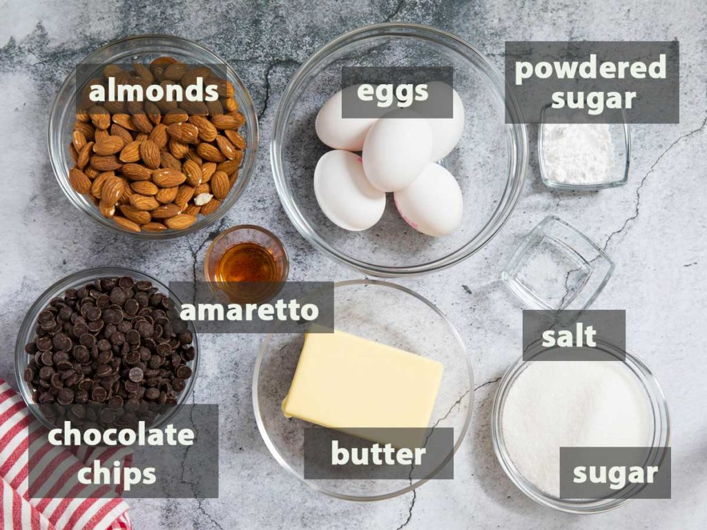 An image showing all the ingredients for making Italian Flourless Chocolate Cake.