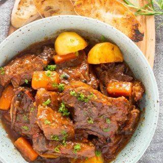 An overhead shot of a plate of Spanish Beef Stew; this is an easy beef stew recipe.