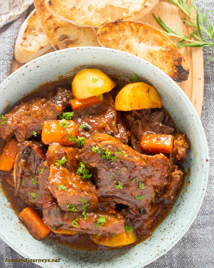 An overhead shot of a plate of Spanish Beef Stew; an easy beef stew recipe that will surely become one of your favorites!