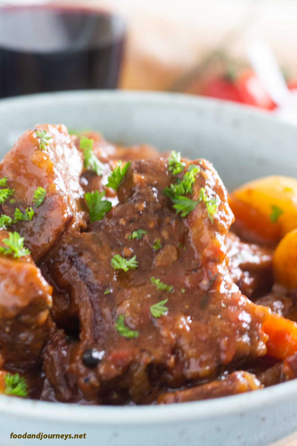 A closer shot of a serving of Spanish Beef Stew, focusing on the stickiness of the sauce; an easy beef stew recipe.