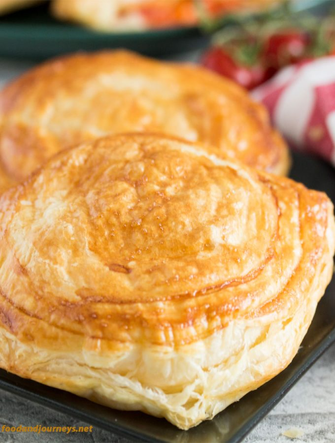 A couple of Rustico Leccese, Tomato and Mozzarella Pastry served for brunch. A type of tomato puff pastry that's considered as street food in Puglia, it's also great for breakfast or snack!