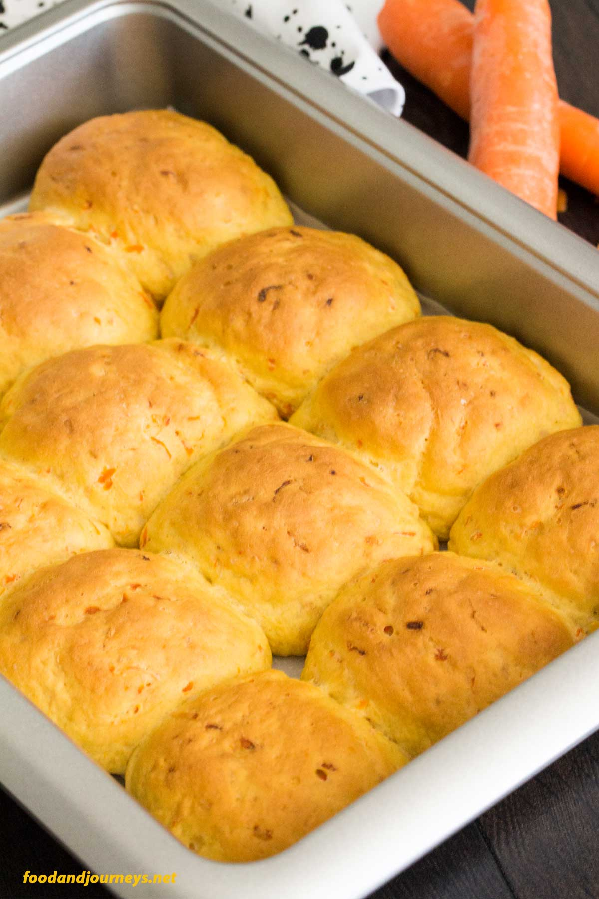 Straight out of the oven! Finnish Carrot Bread Rolls, still on a baking pan, to be moved to a bread basket for serving. You get bread and vegetable with every bite of these carrot rolls!