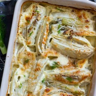 Baked Fennel with Parmesan & Cream on a baking dish. Comfort food does not have to be pasta or meat all the time. This is a healthier alternative! This baked vegetable is also great as a side dish for roasted or grilled meat!