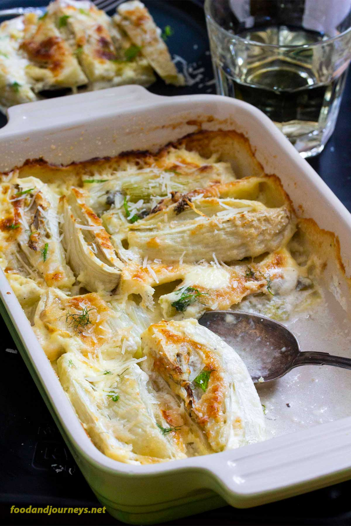 Taking a serving of Baked Fennel with Parmesan & Cream. You would be surprised on how easy it is to prepare this vegetable side dish. Creamy fennel bulbs coated with parmesan and breadcrumbs on every bite!