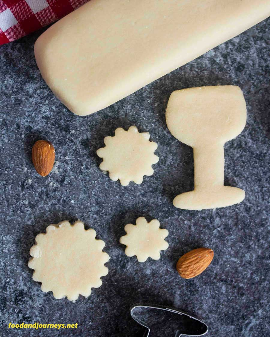 Overhead shot of homemade marzipan cut into shapes, from how to make marzipan post
