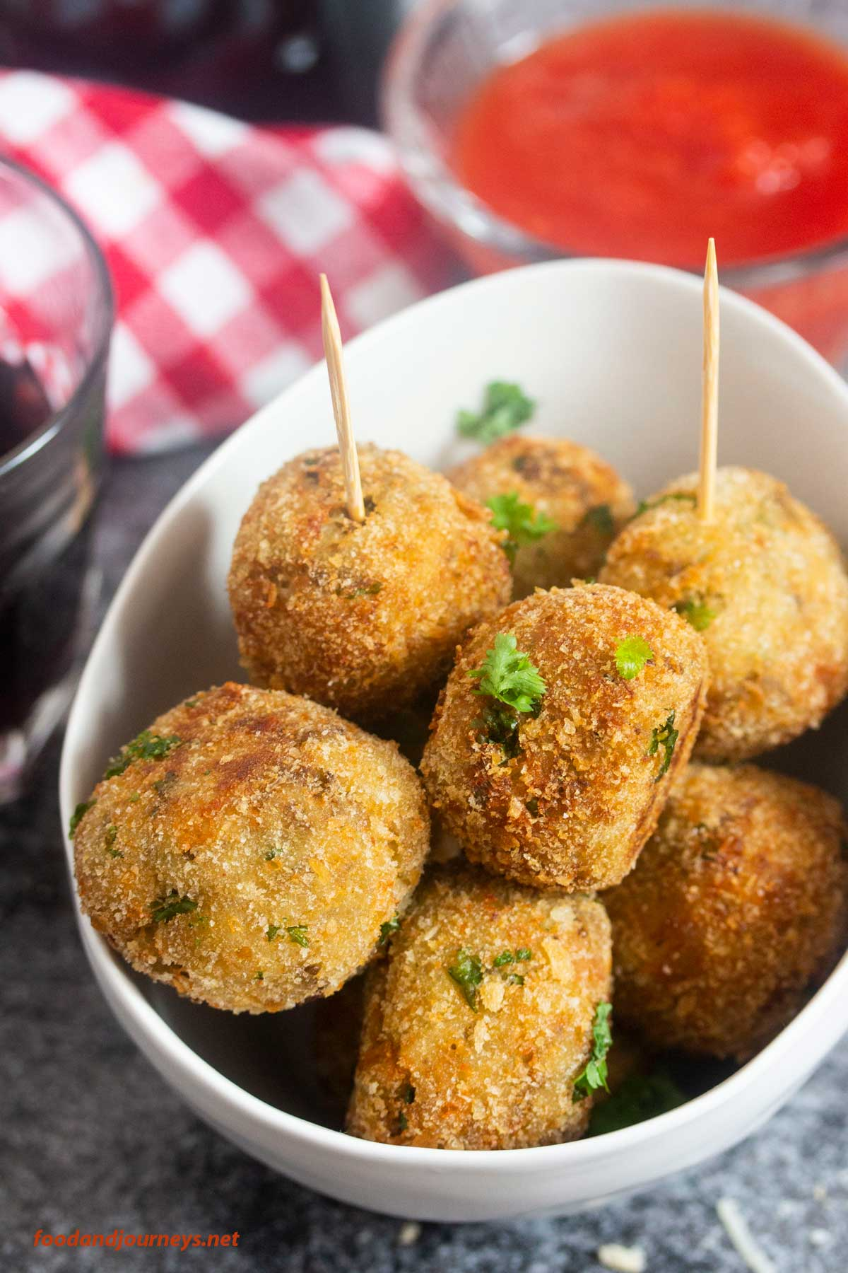Polpette di Melanzane served in a bowl, with toothpicks for picking