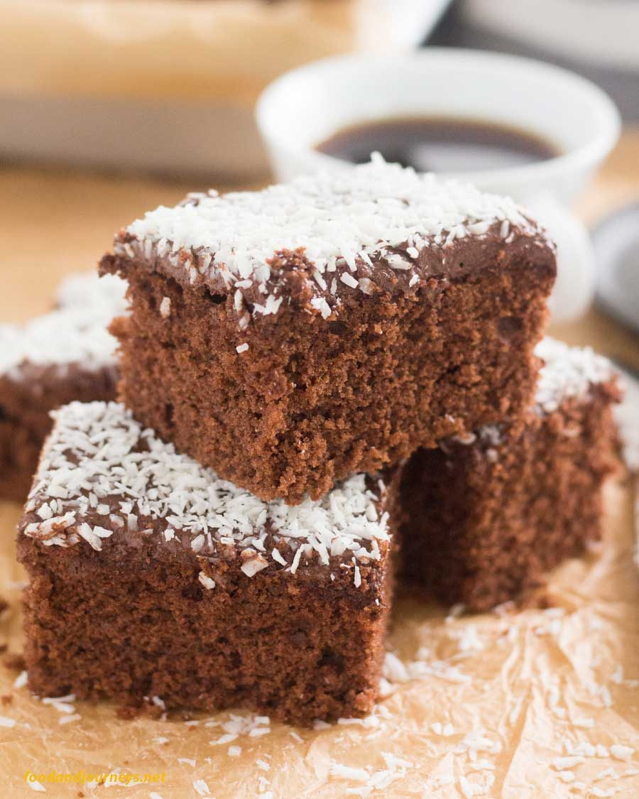 Swedish Chocolate-Coffee Squares served with a cup of coffee, part of Swedish Food Recipes You Must Try