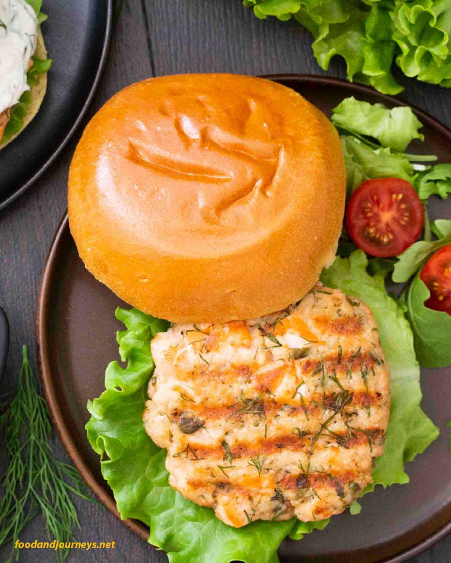 An overhead shot of Swedish Salmon Burger with Lemon Yogurt Sauce on the side , part of the article Swedish Food Recipes You Must Try.