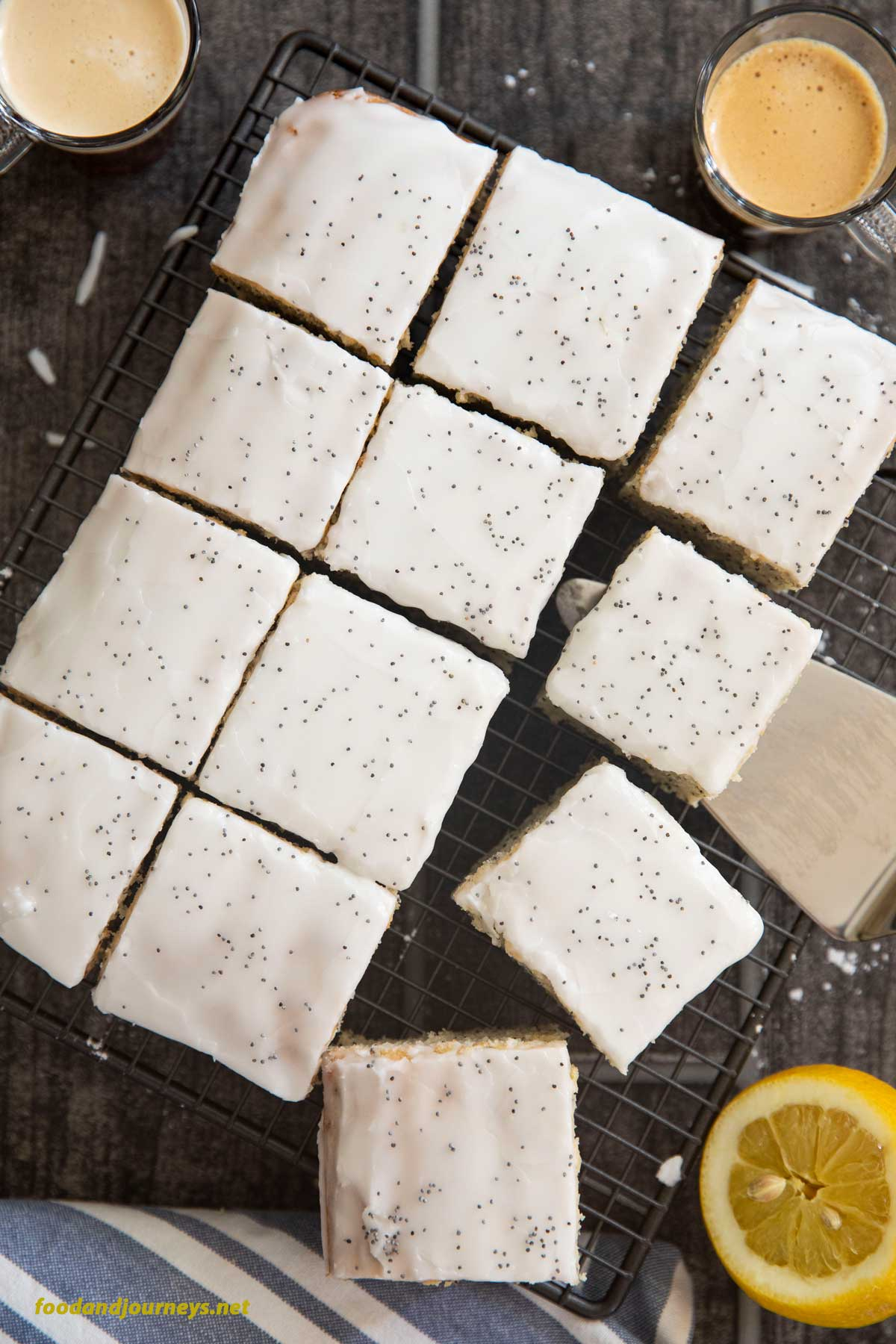 An overhead shot of slices of French Lemon Poppy Seed Cake cooling on a rack.