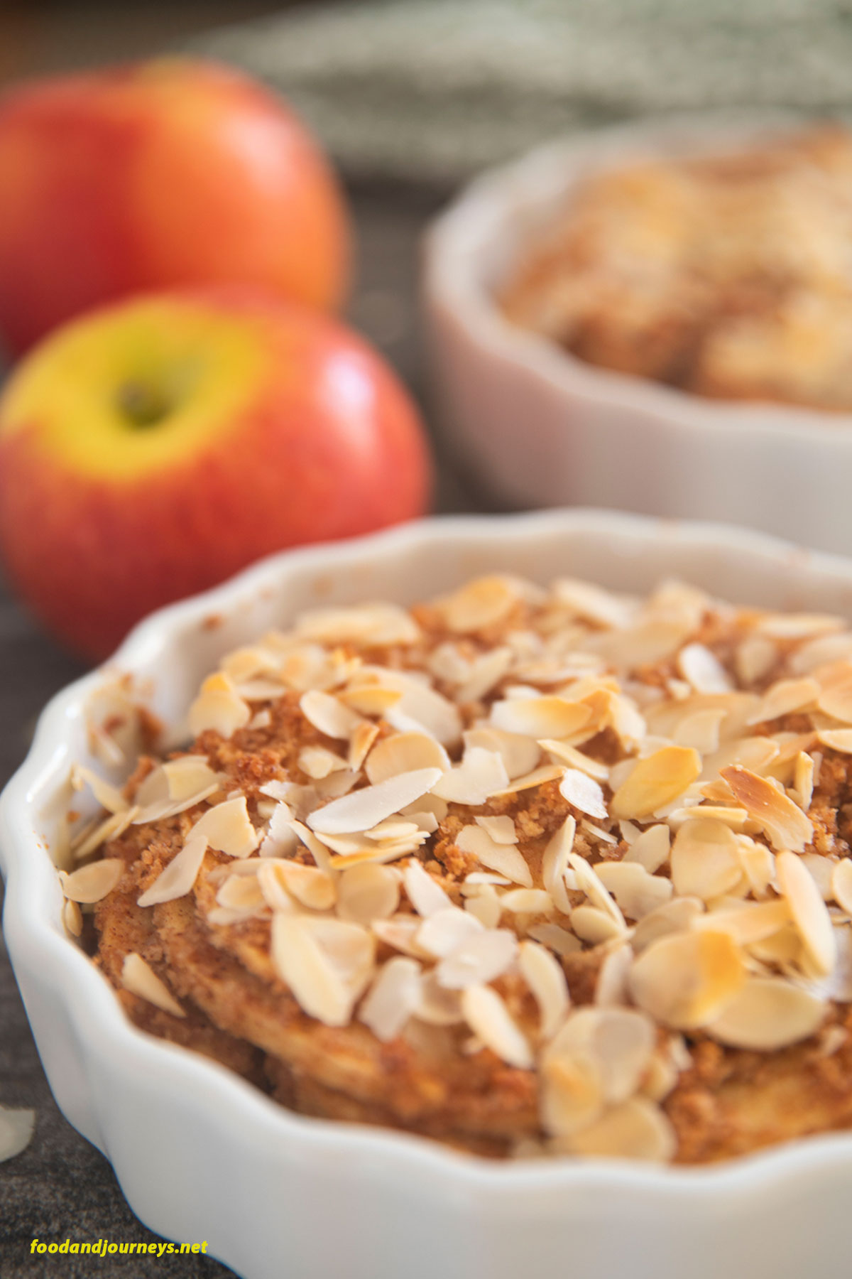 A closer shot on a small pan of Swedish Apple Crumble highlighting the crunchy slices of almonds on top