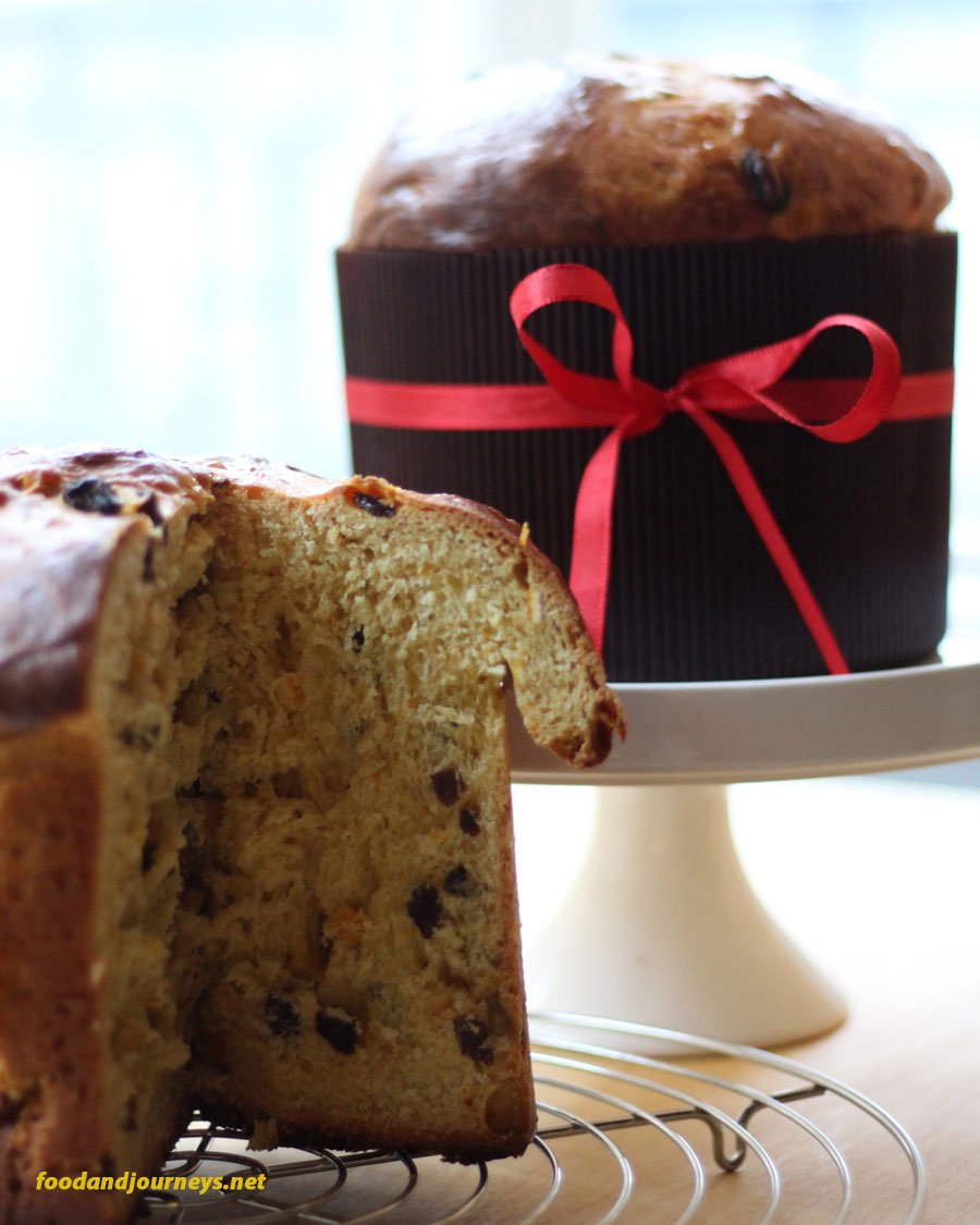 Two loaves of panettone, one with a sliced portion to show the texture of the cake.