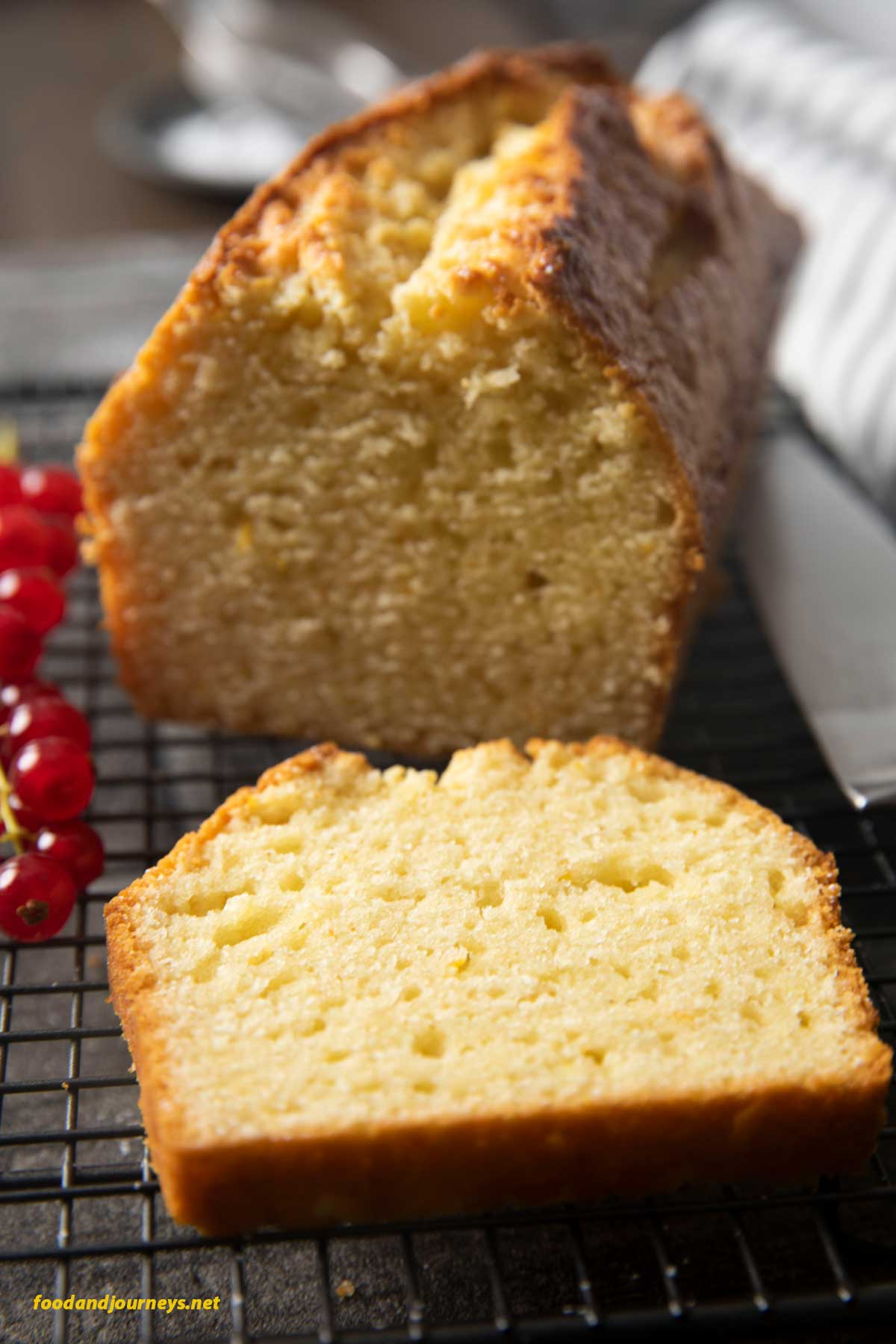 A closer shot of a slice of a freshly made orange yogurt cake,