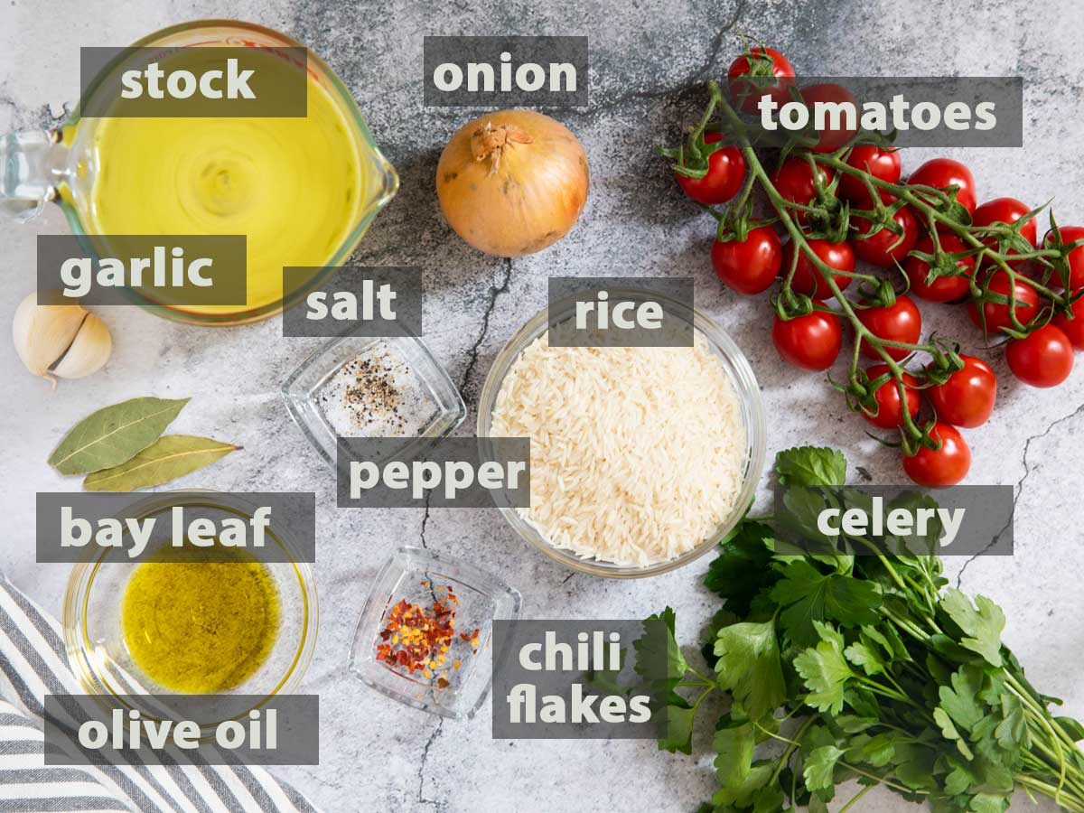 An image showing all the ingredients needed for making Tomato Rice