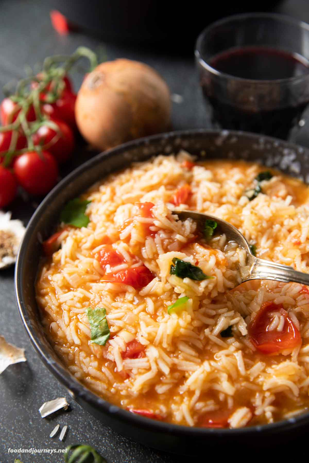 A closer shot of a serving of Portuguese Tomato Rice, highlighting the bits of tomatoes and parsley with the rice.