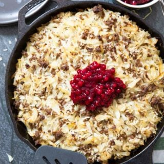 An overhead shot of Finnish Ground Beef & Cabbage Casserole, with lingonberries jam on top.