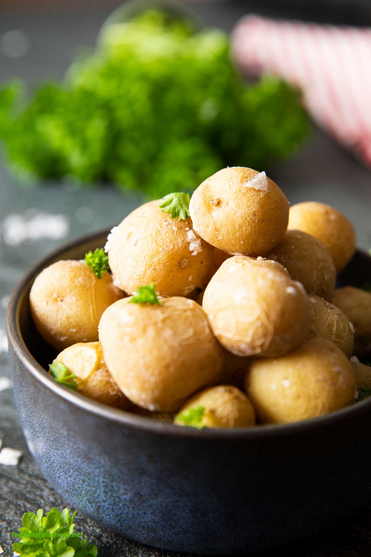 A closer shot of a bowl of freshly baked salt-crusted potatoes, ready for serving.