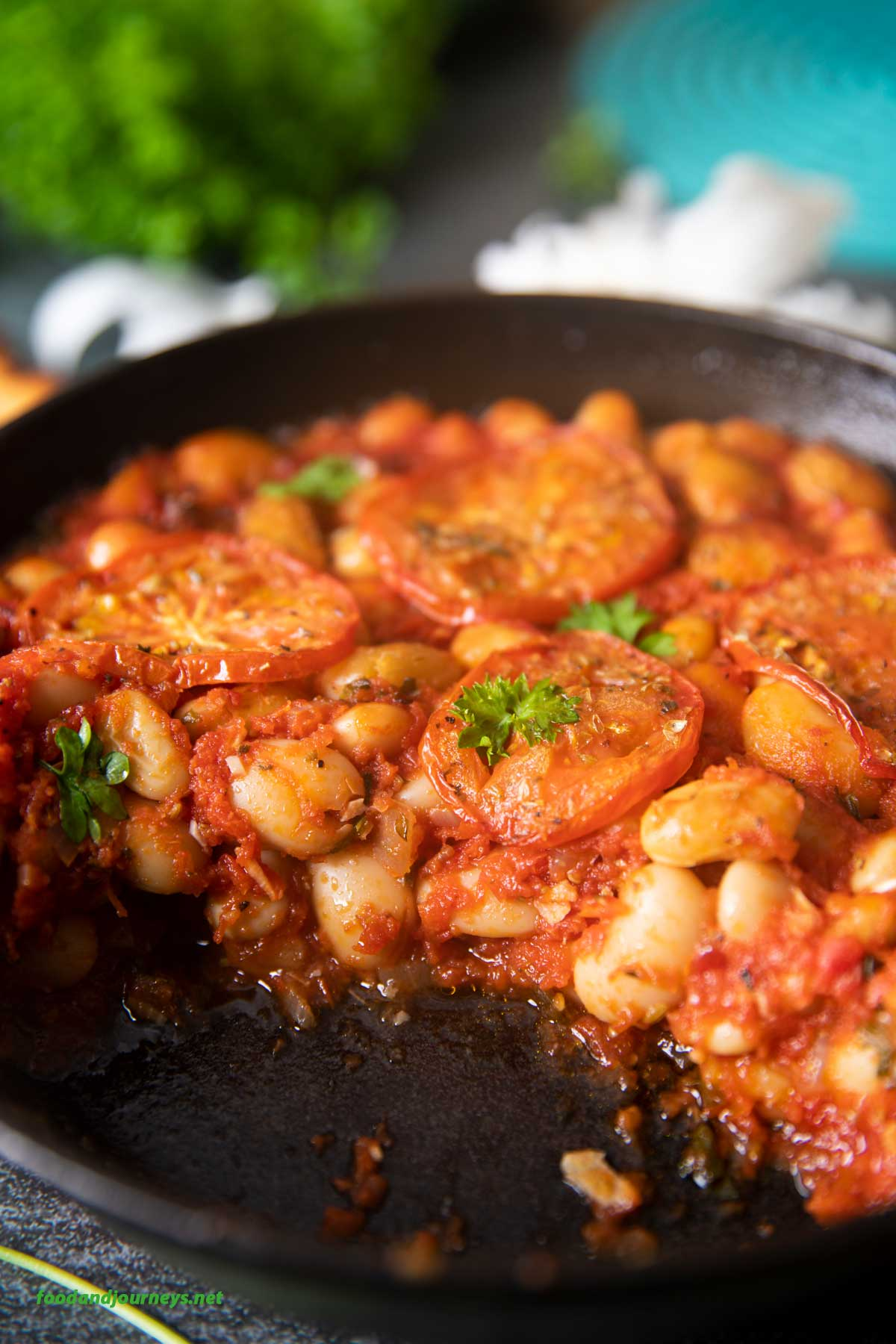 A closer shot of the inside of the beans in tomato sauce, highlighting the flavorful tomato sauce with the butter beans.