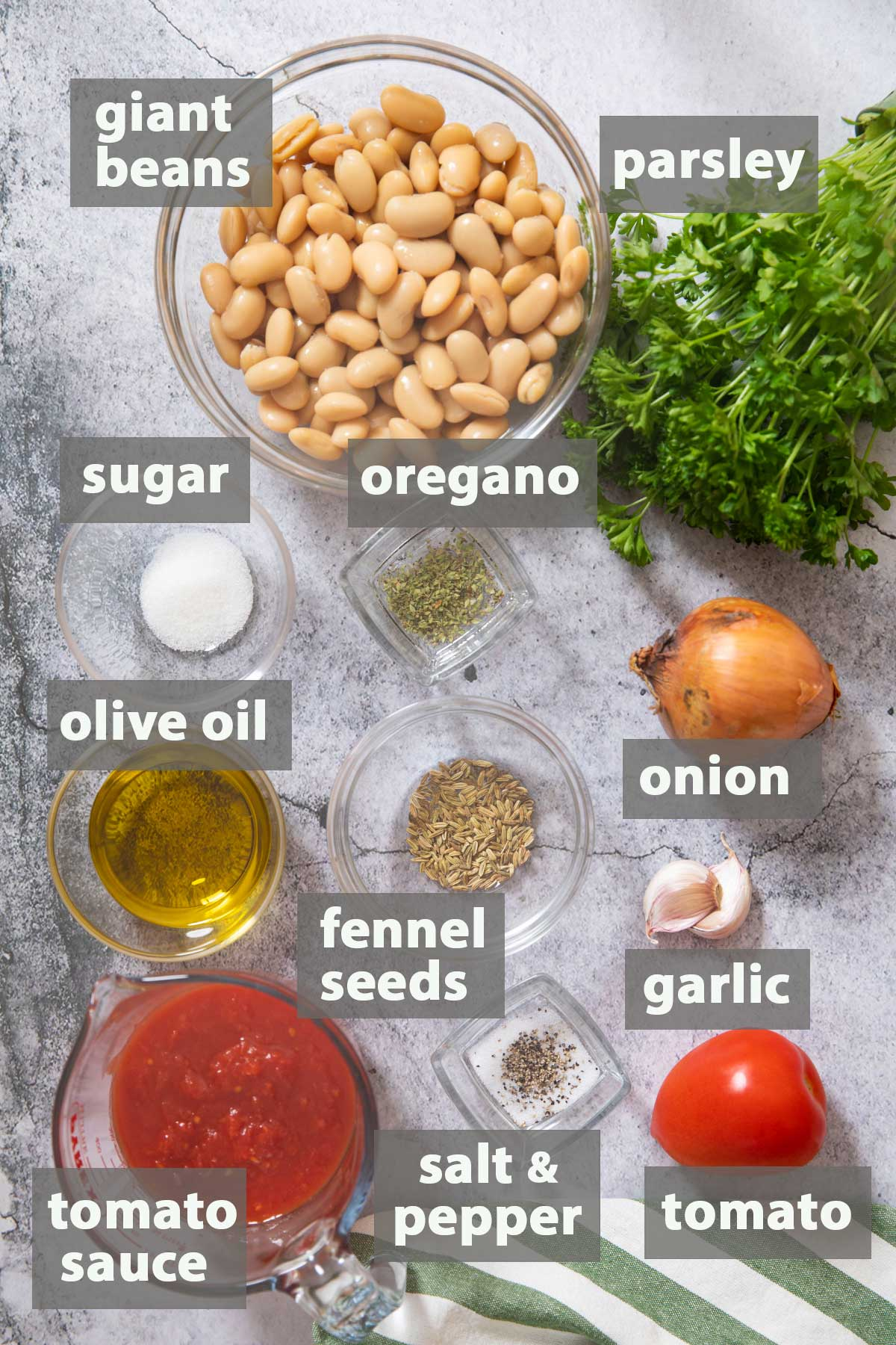 An image showing all the ingredients that you need to have to prepare Baked Giant Beans at home.