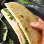 Pinterest Image for Italian Flatbread, showing a sandwich made of flatbread, mortadella slices and some rucola.