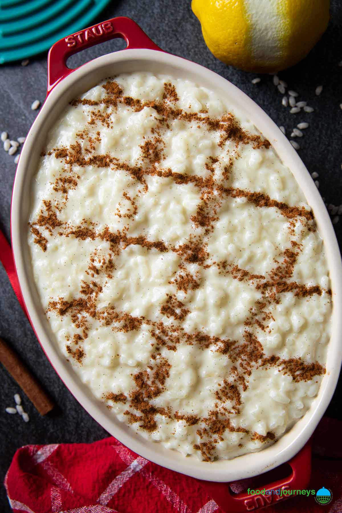 An overhead shot of creamy rice pudding, decorated with cinnamon powder, ready for serving.