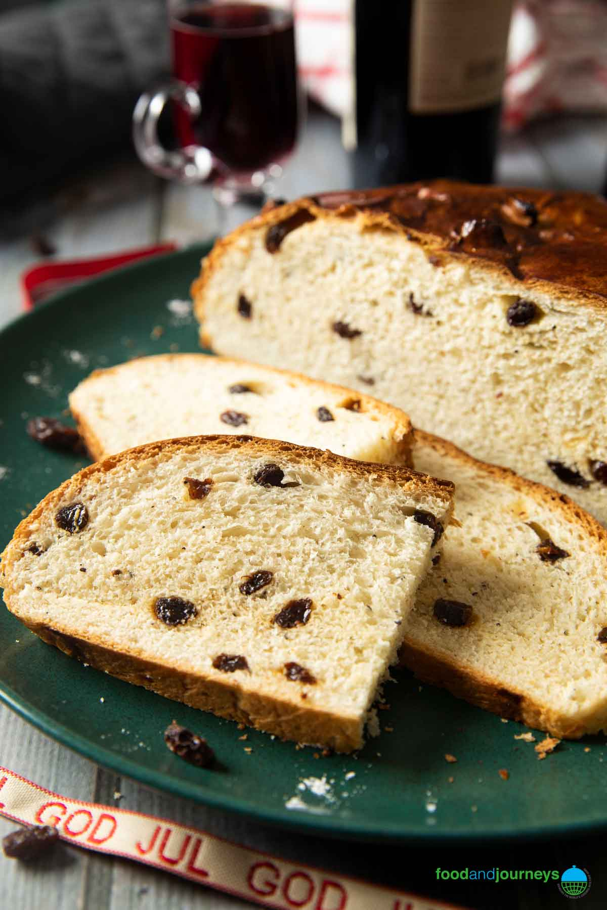 A classic Christmas bread from Norway, Julekake shown here as slices, highlighting the raisins inside and the soft texture of the bread.