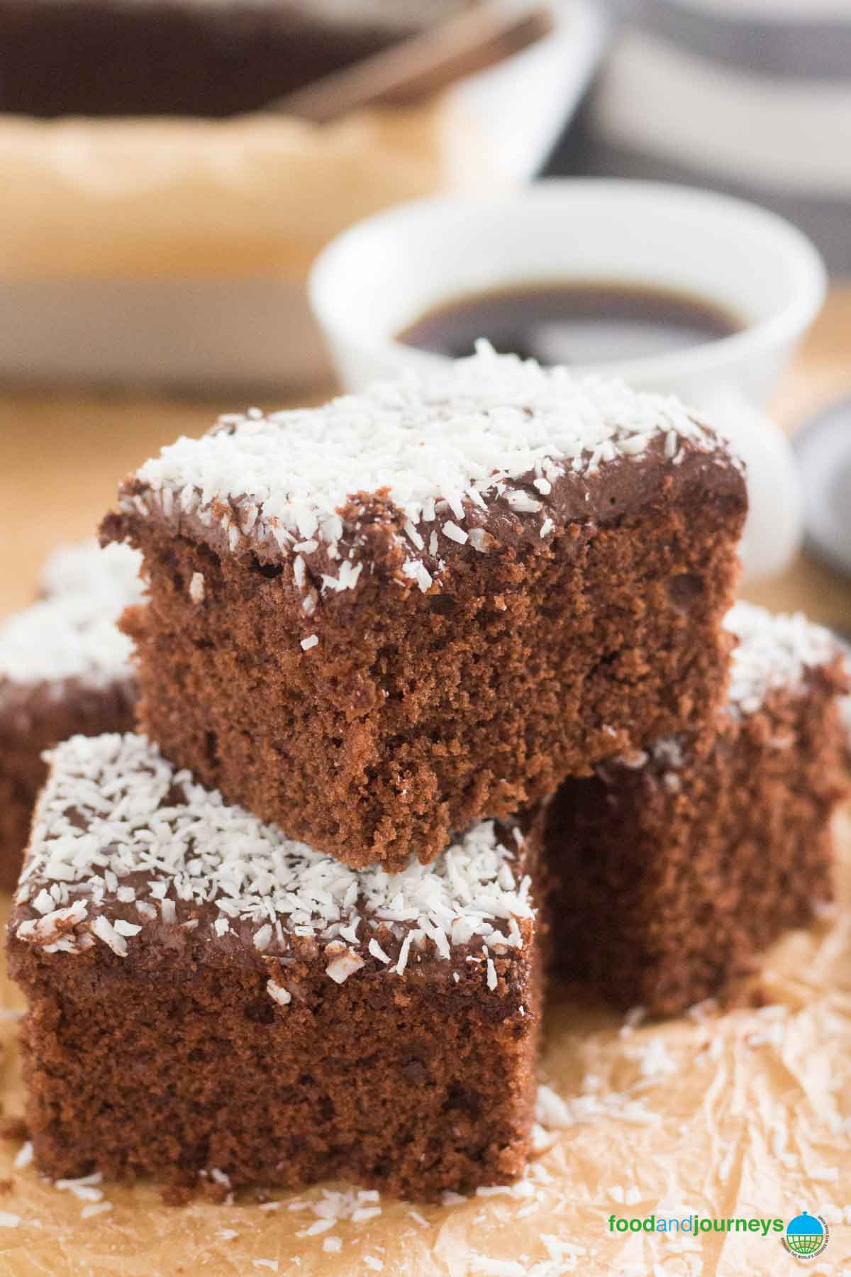Swedish Chocolate Coffee Squares, served with a cup of coffee, ready to be enjoyed.