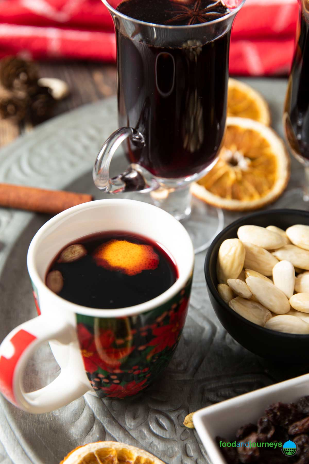 An image that shows how Swedish glogg is served, with raisins and blanced almonds.
