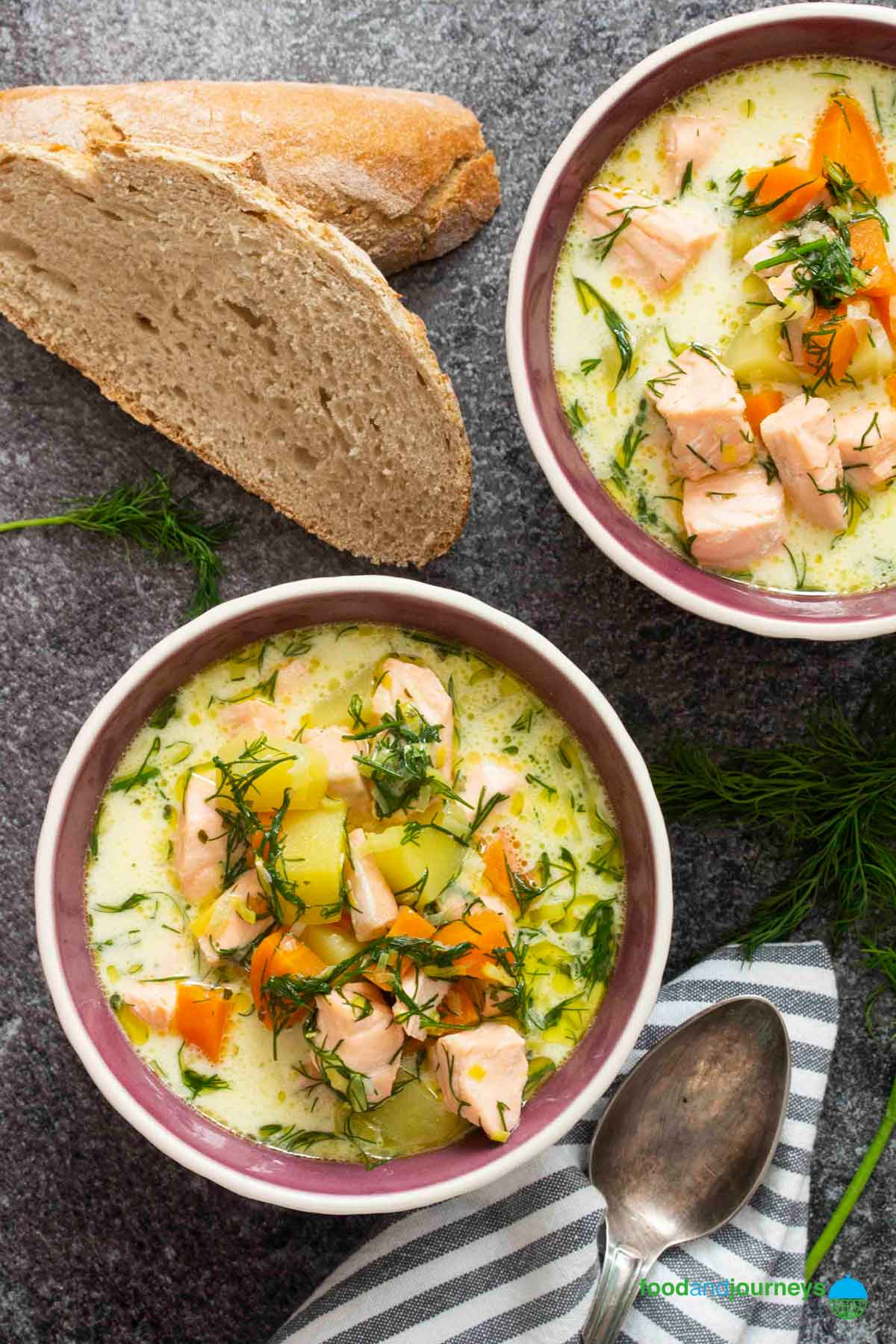 An overhead shot of Finnish Salmon Soup, as part of Winter Soup Recipes around the World; served with a chunk of bread on the side.