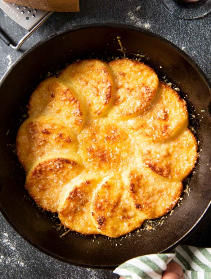 An overhead shot of a pan of Gnocchi Alla Romana, straight out of the oven, ready for serving.