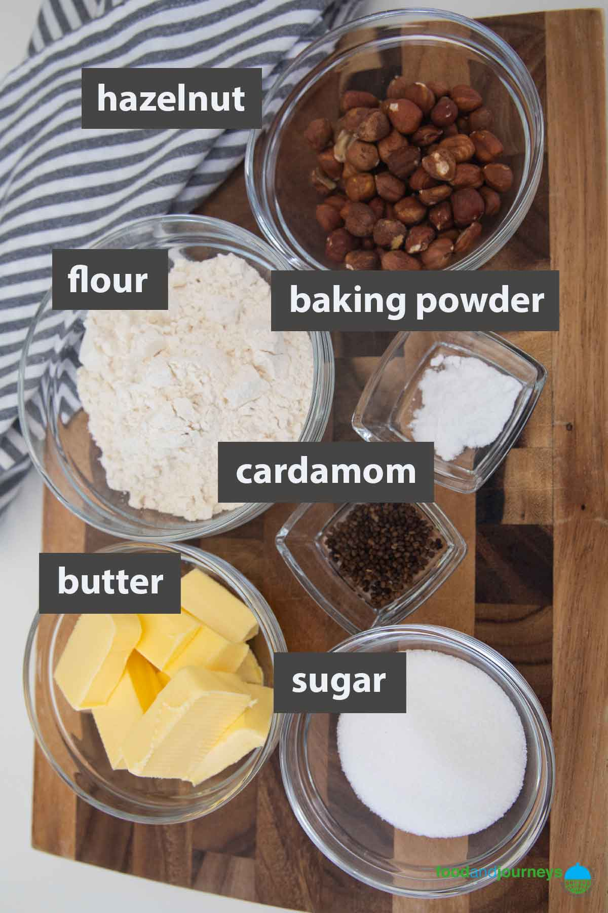 An image showing all the ingredients that you need to prepare cardamom cookies at home.