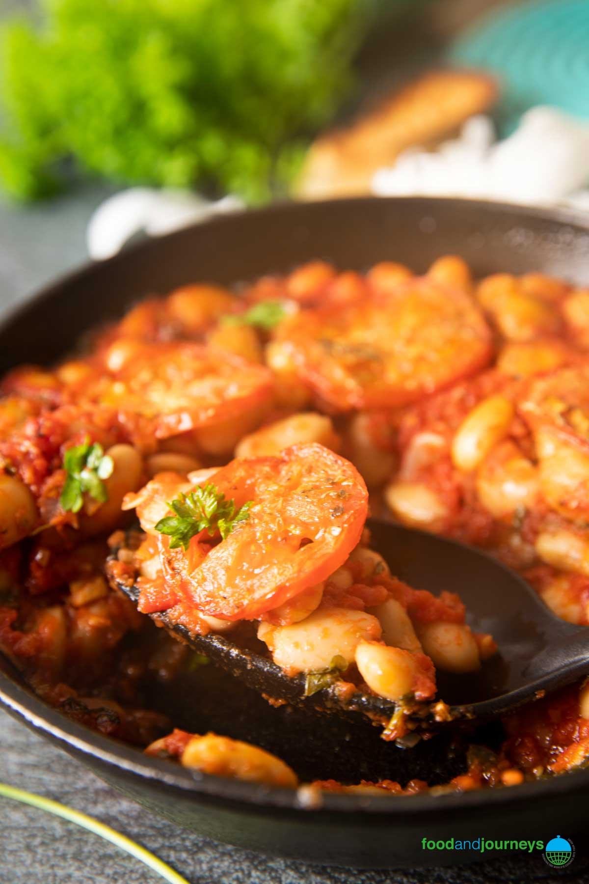A closer shot of roasted tomatoes and baked beans, ready for serving.