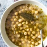 A serving of Greek Chickpea Soup, with some kalamata olives on the side.