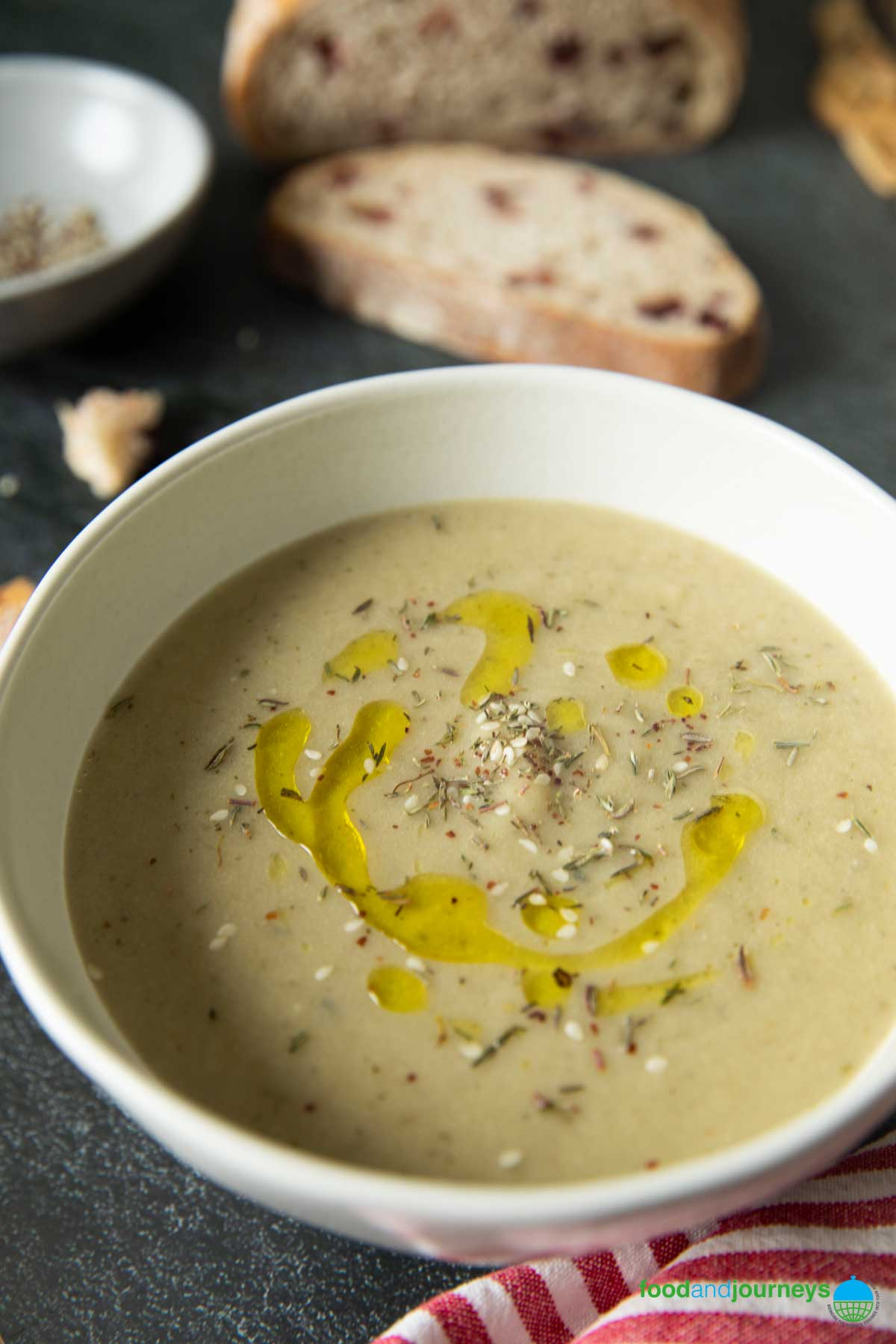 A closer shot of a serving of Turkish-Style Roasted Eggplant Soup, highlighting the texture of the soup.
