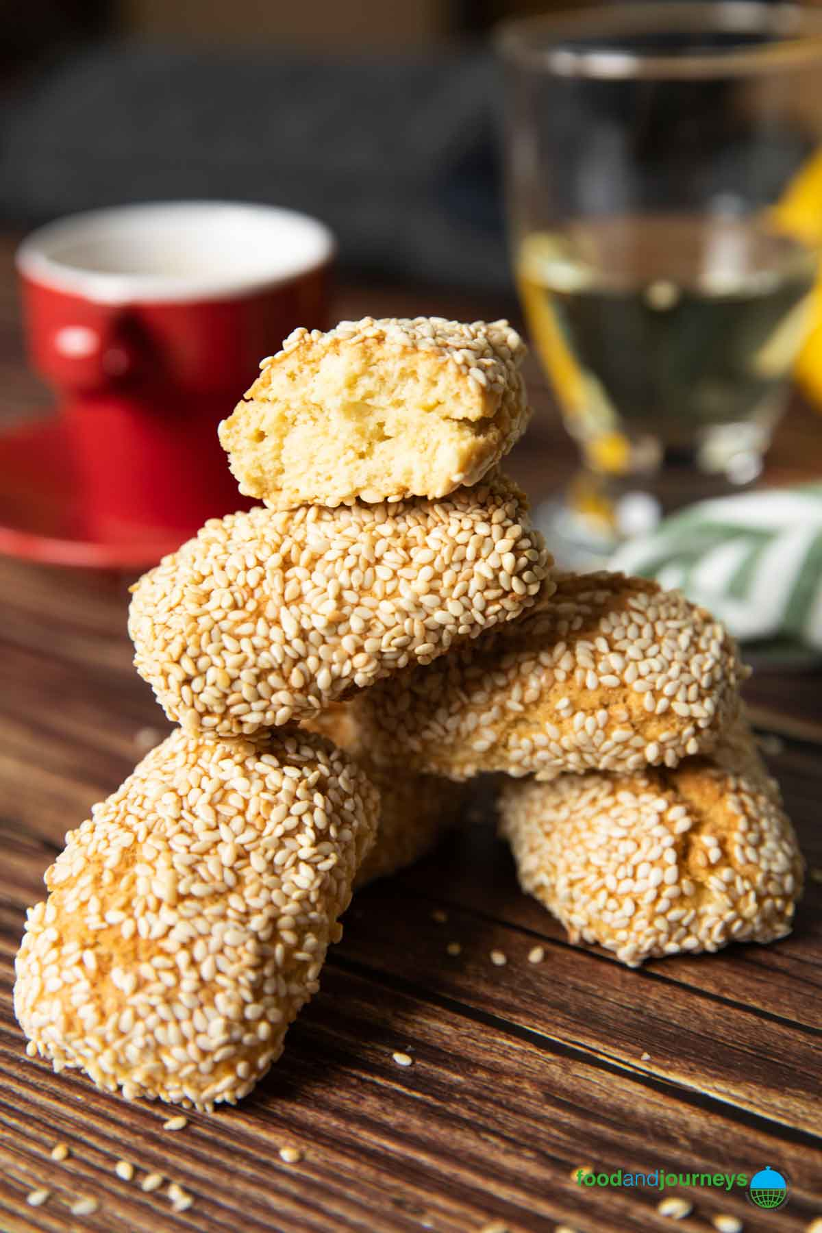 A stack of Italian sesame cookies with a cup of espresso on the background.