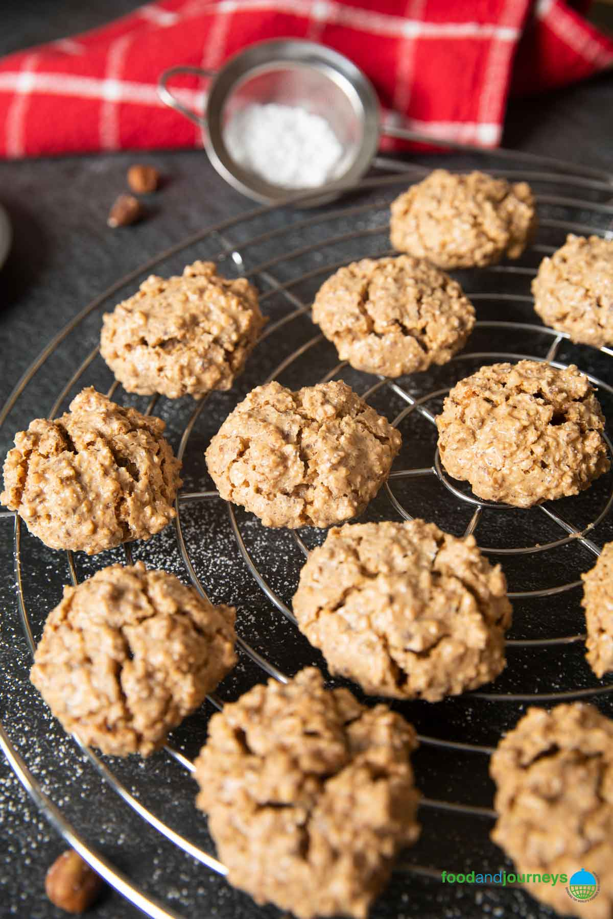 Freshly baked hazelnut meringue cookies on a cooling rack.