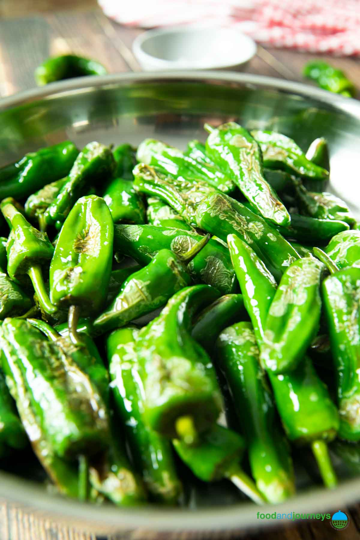 A closer shot of a pan of padron peppers, ready for serving.