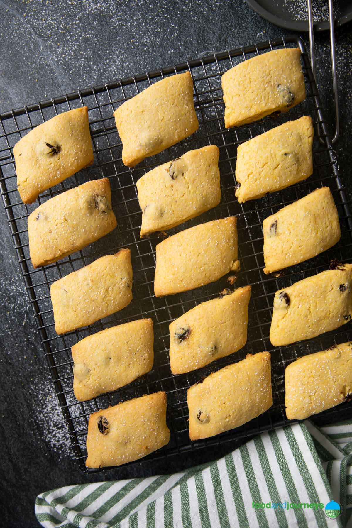 Venetian Cornmeal Cookies, fresh out of the oven, on a cooling rack.