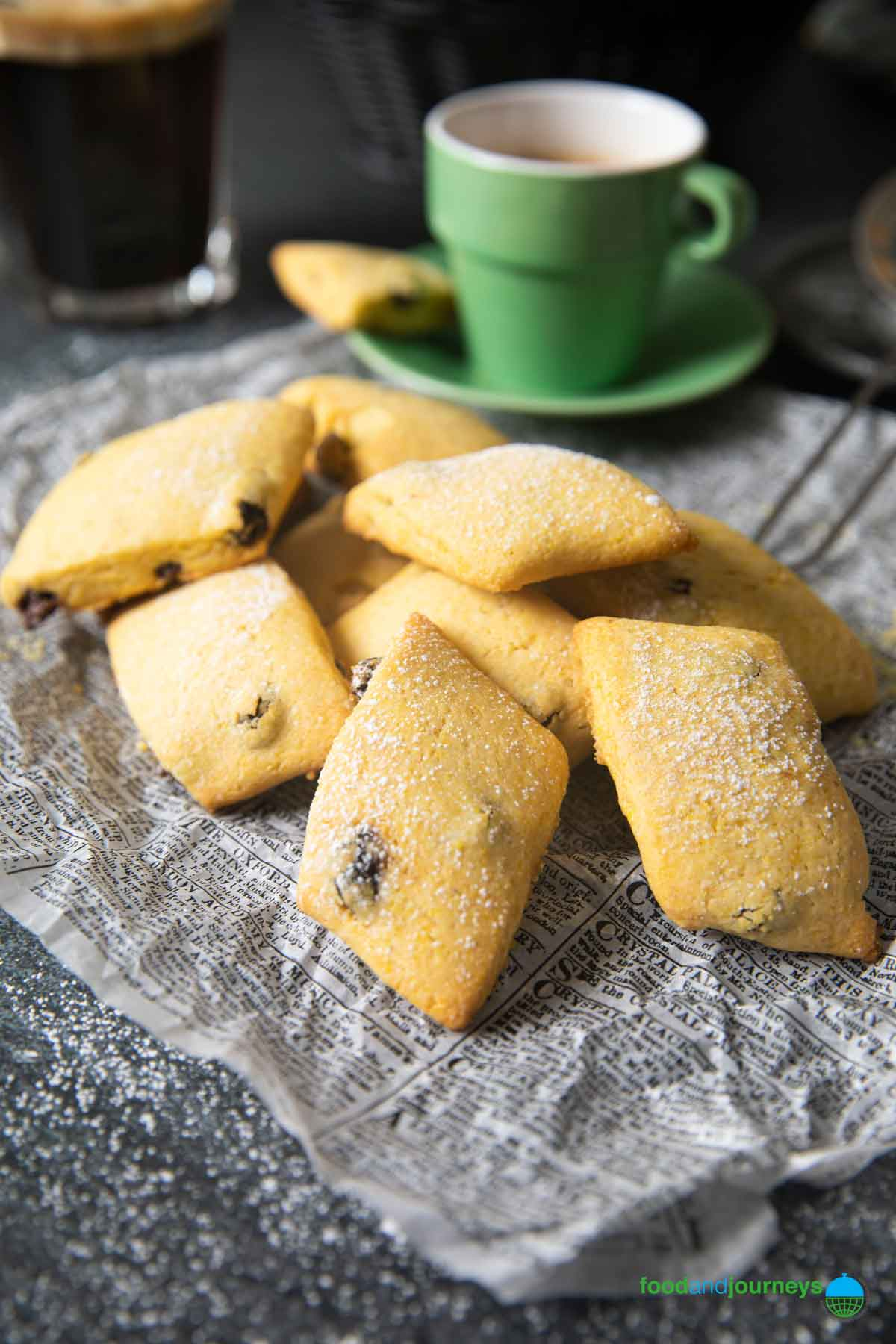 A stack of cornmeal cookies from Veneto, dusted with powdered sugar and served with an espresso.