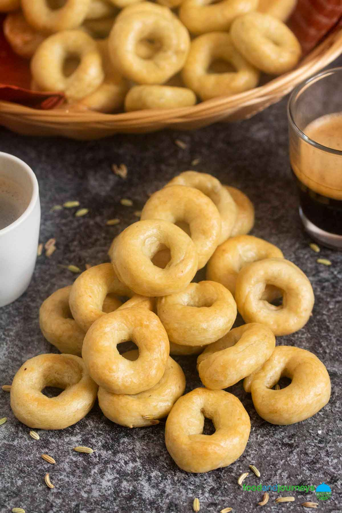 A closer shot of a bunch of taralli served with a couple of espresso.