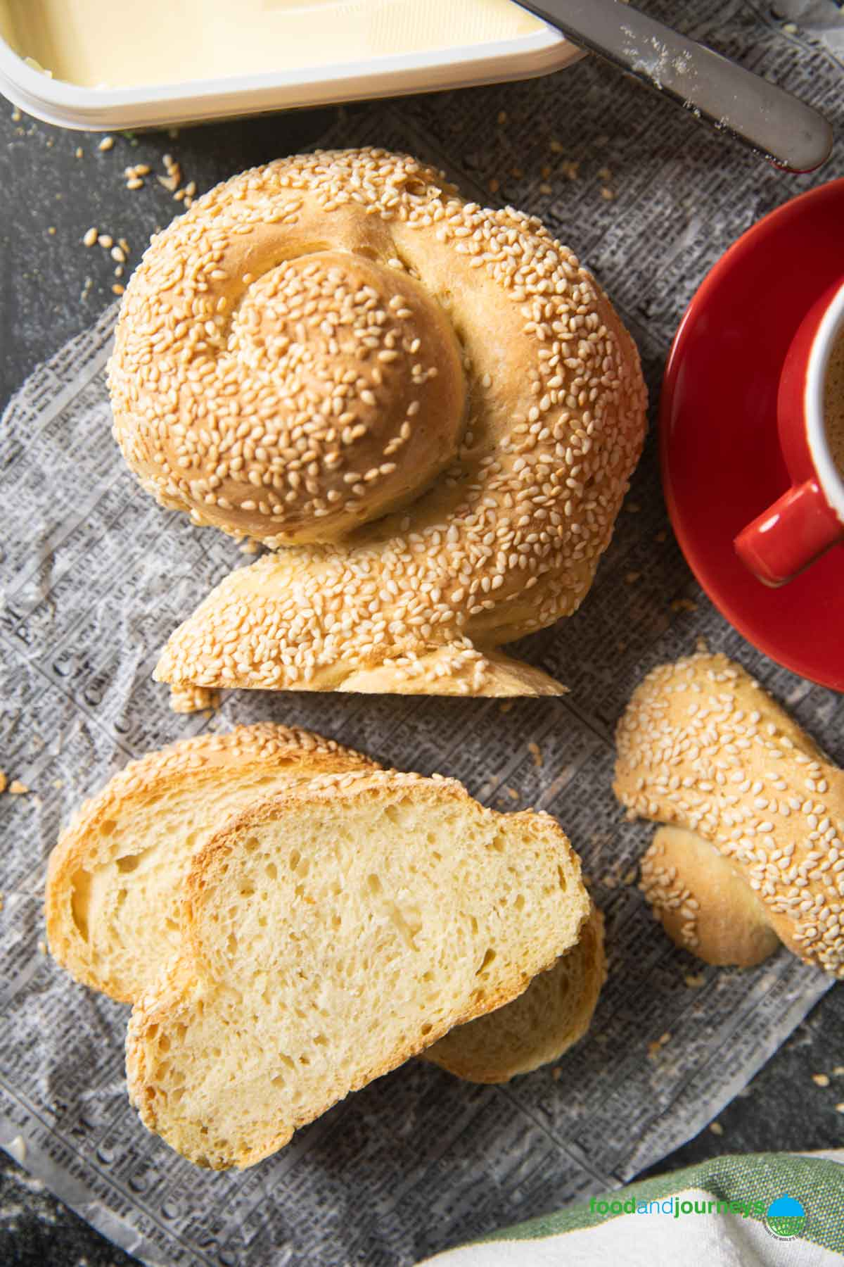 An overhead shot of Pane Siciliano, served with a cup of espresso, and some slices ready to be enjoyed.