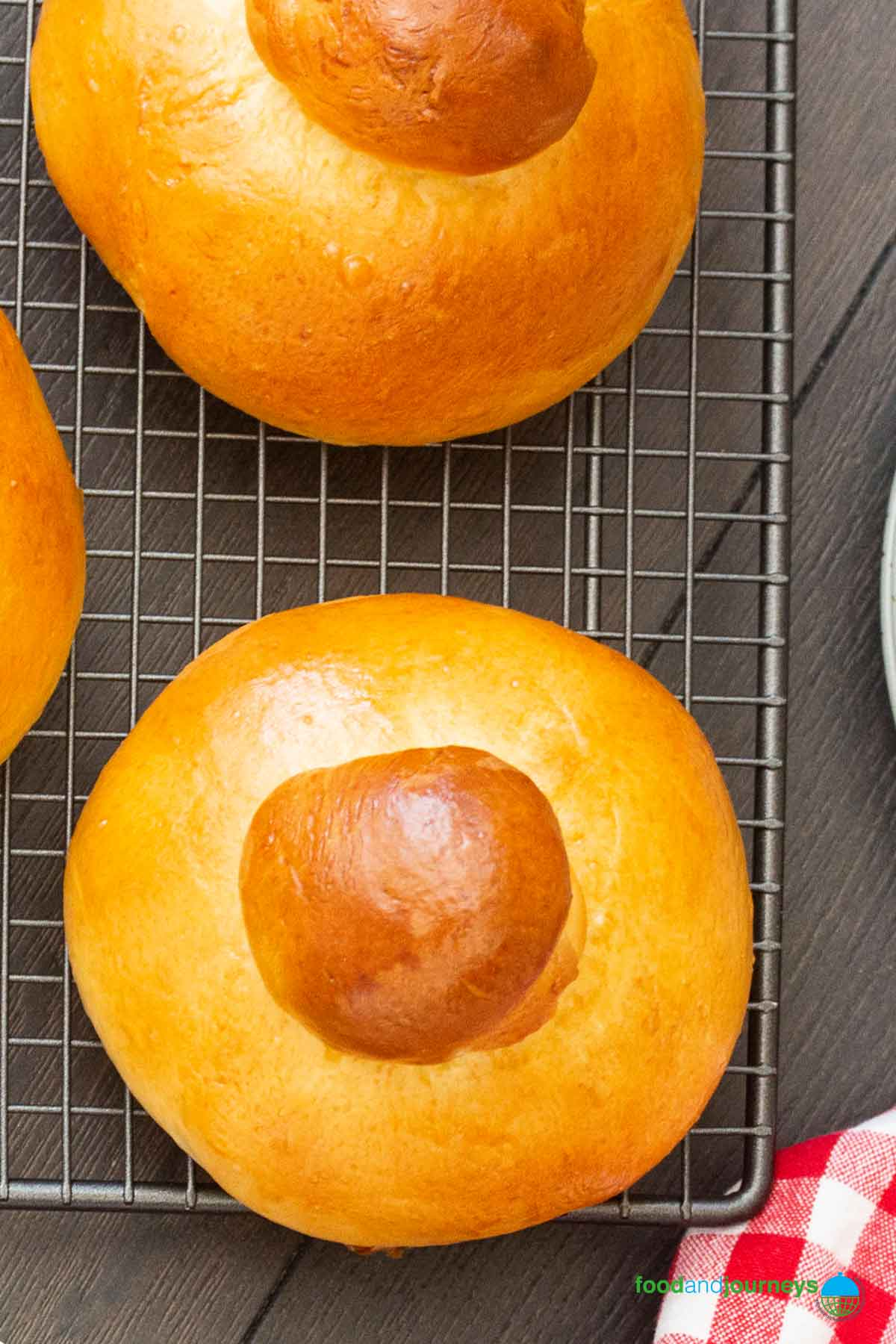 Freshly baked Sicilian brioche cooling on a rack.
