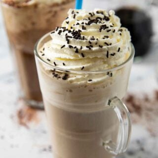 A tall glass of eiskaffee with chocolate sprinkles, ready for serving.