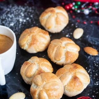Updated image for marzipan cookiees served with a cup of coffee.