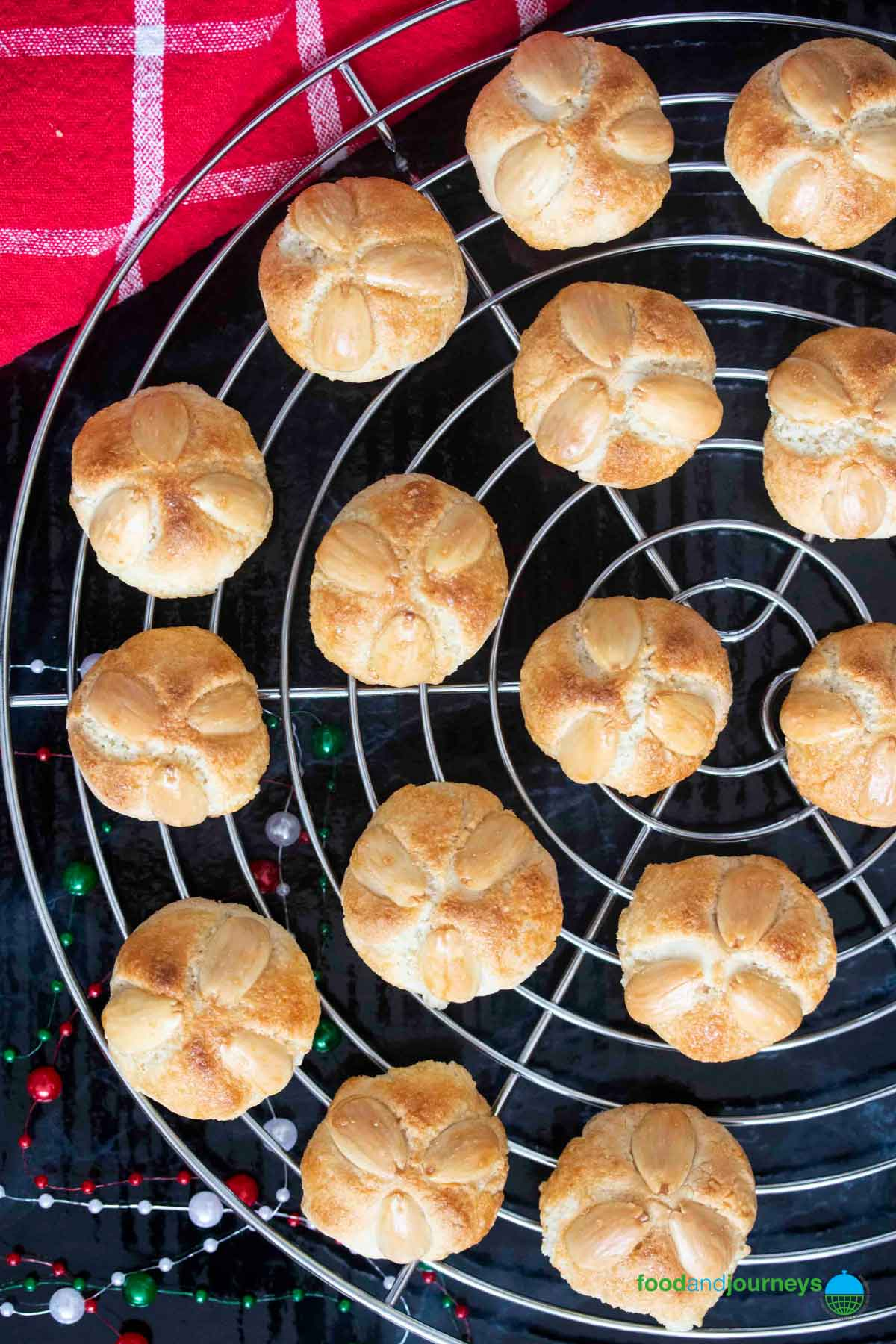 Freshly baked marzipan cookies on a cooling rack, before serving.
