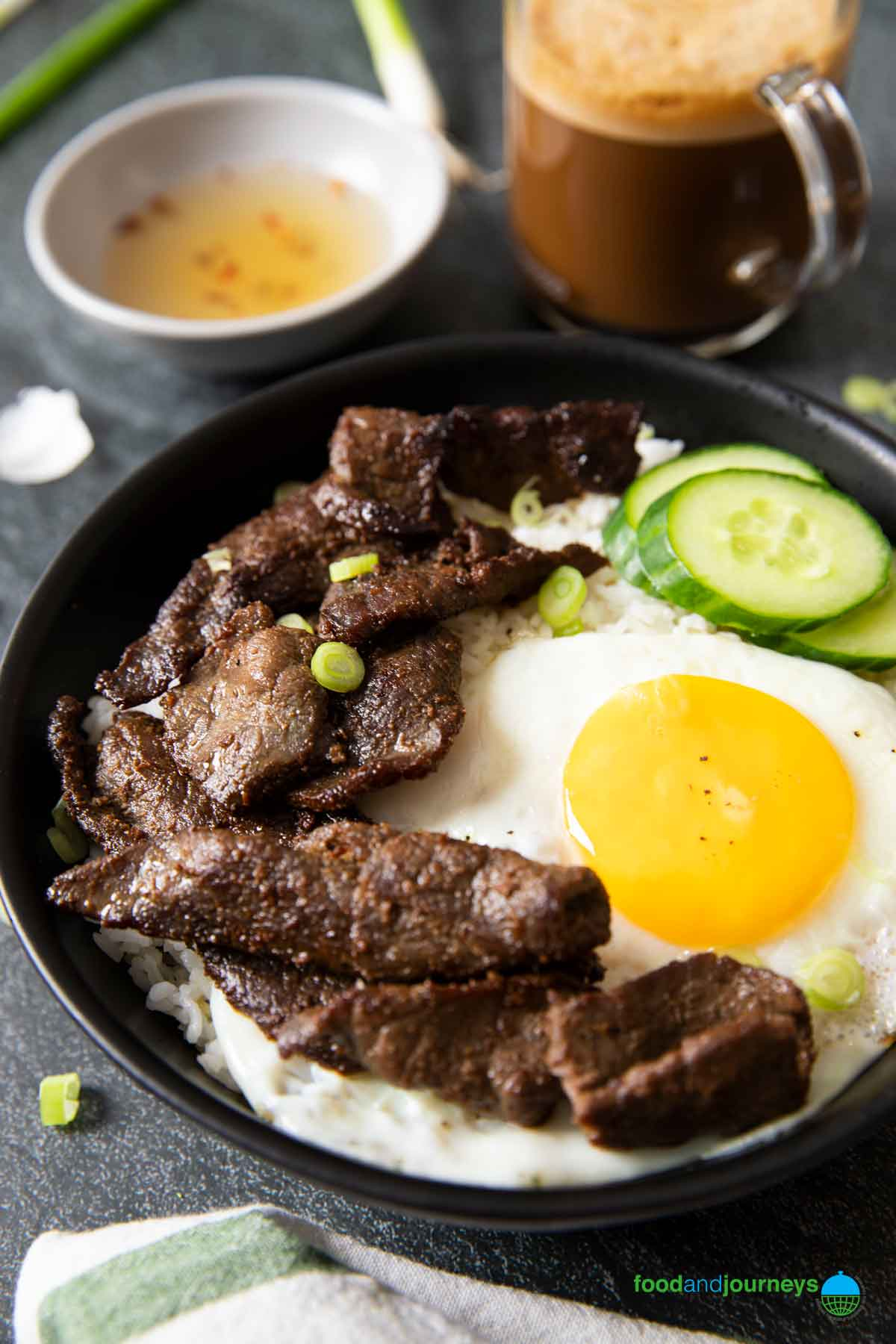 A closer shot of a serving of tapsilog, highlighting the slices of beef.