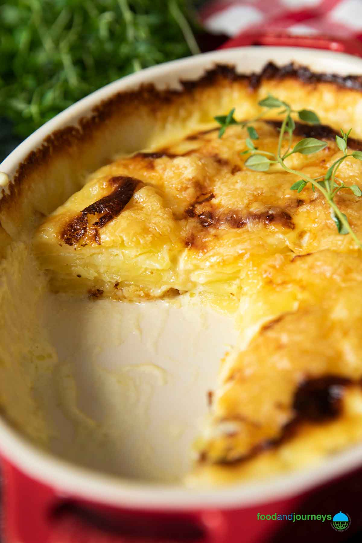 A closer shot of the layers of the gratin, showing the cooked potatoes, and not drowning in cream.
