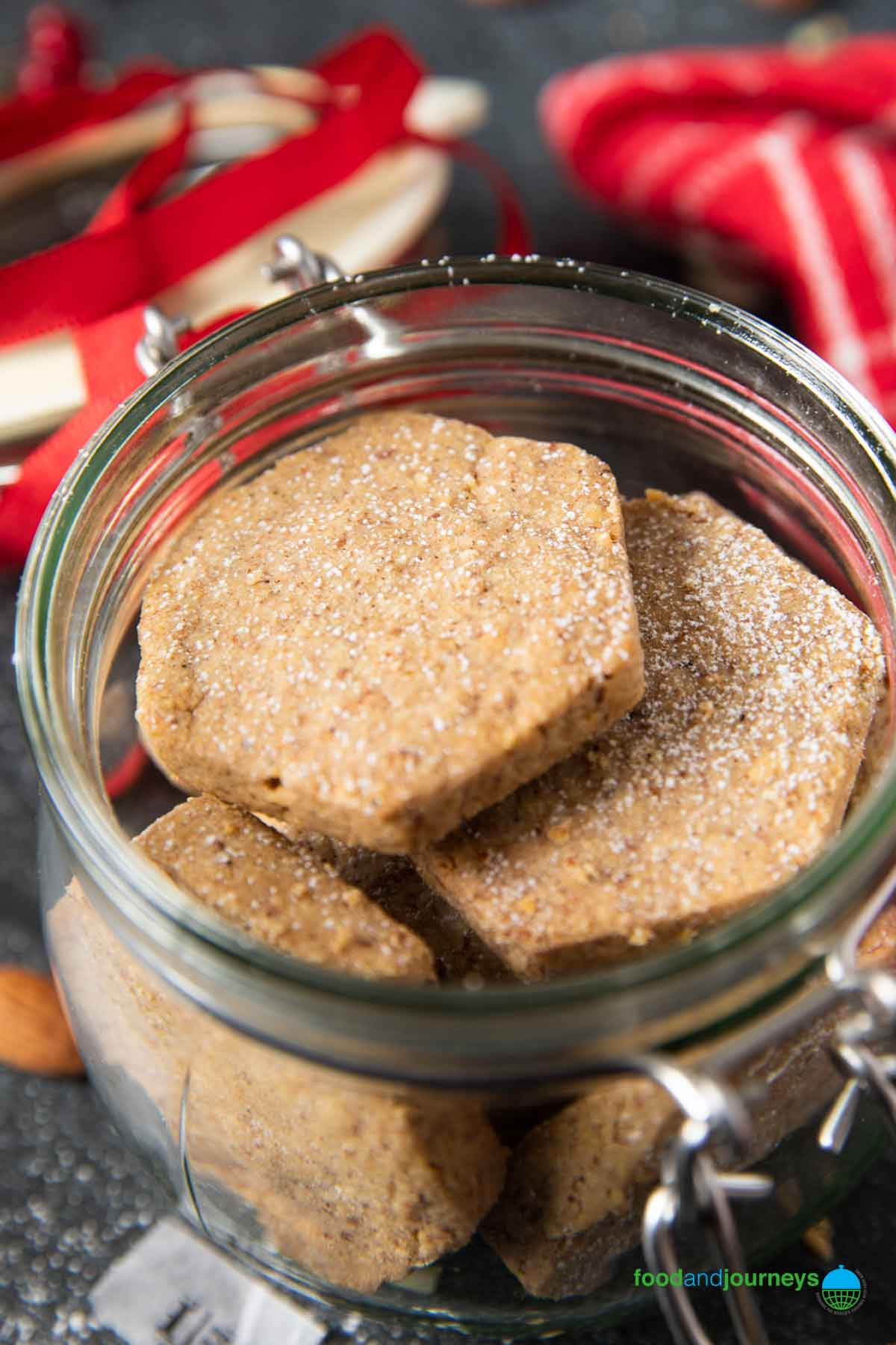 Cooled polvorones placed in a jar for longer storage.