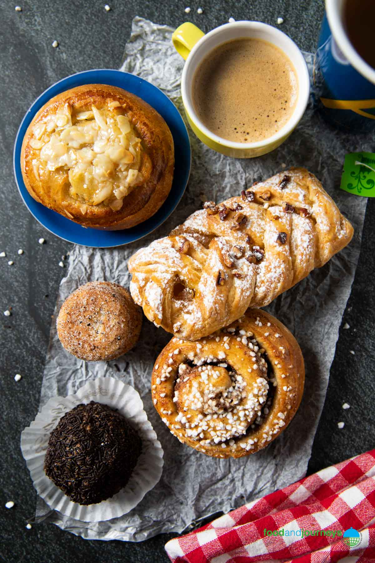 An overhead shot of a combination of Swedish treats and pasties, to be enjoyed for fika.